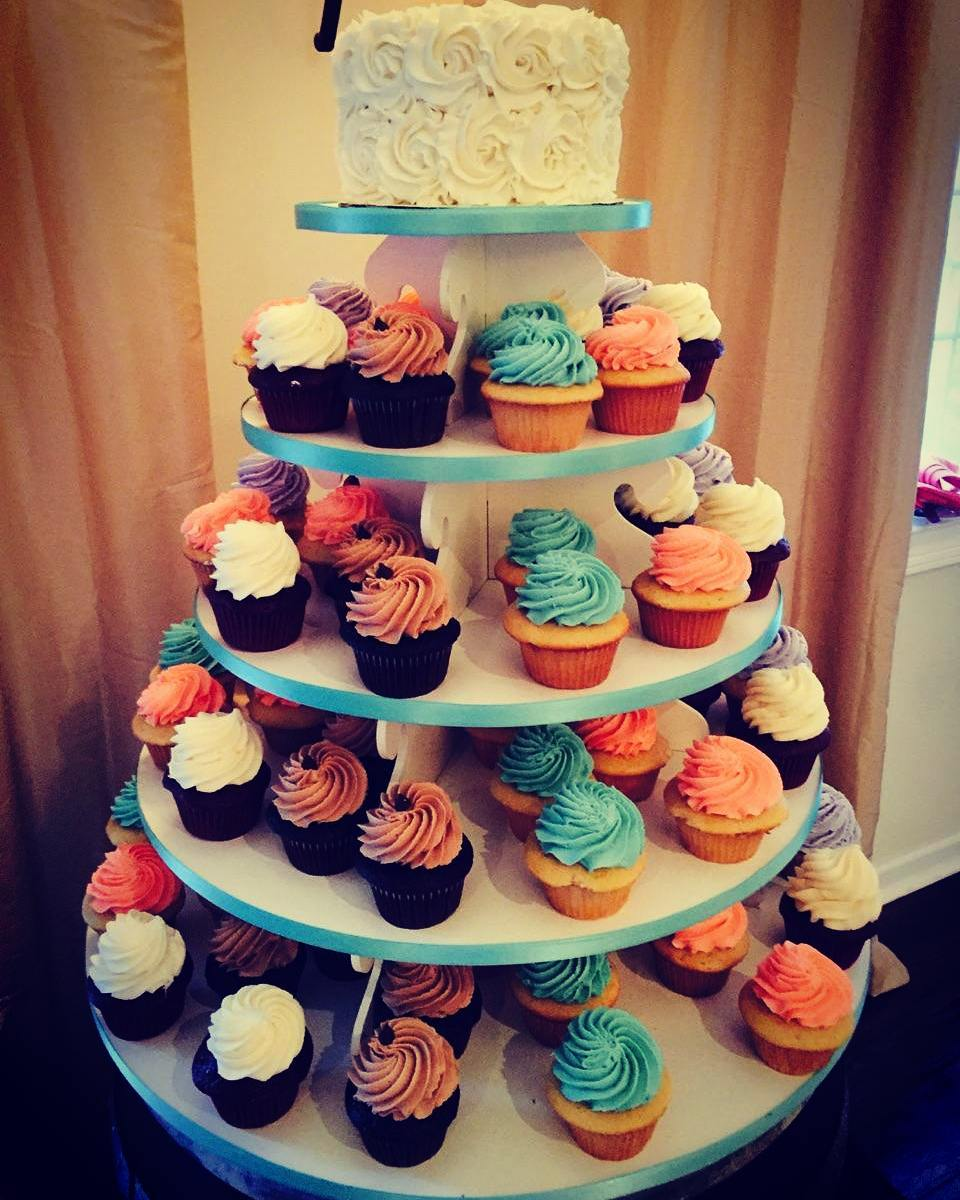 Wedding Cupcake Tower With White Roses Cutting Cake